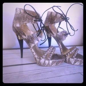 Bebe snake skin platform heels